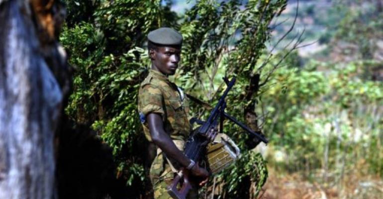 A Burundian soldier patrols the perimeter of the southern district of Musaga in Bujumbura.  By Marco Longari (AFP/File)