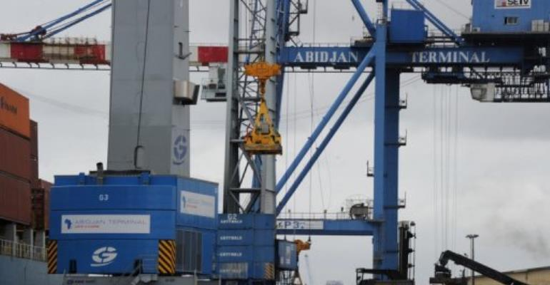 Cranes are pictured on the docks of Abidjan's port on October 4, 2012.  By Sia Kambou (AFP/File)