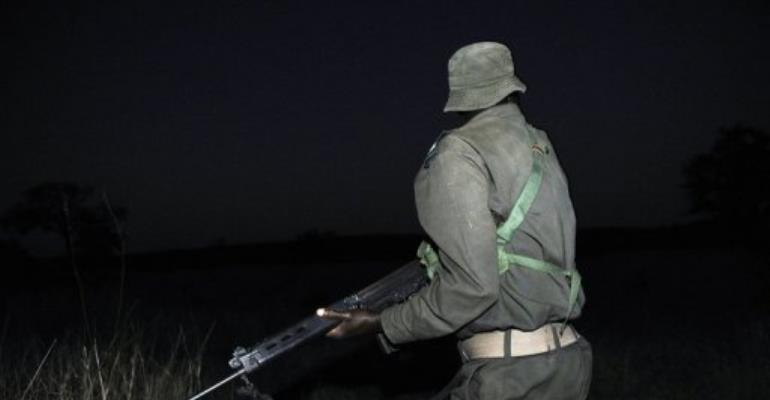 A ranger from South African National Parks (SANParks) participates at a night patrol exercice.  By Stephane de Sakutin (AFP/File)