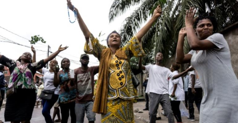 Protestors take to a Kinshasa street for a march against President Joseph Kabila on February 25.  By John WESSELS (AFP)
