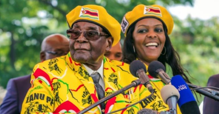 President Mugabe and his wife Grace addressed party members after the vice president, Emmerson Mnangagwa, was sacked -- a move that was followed by the military's warning on Monday.  By Jekesai NJIKIZANA (AFP)