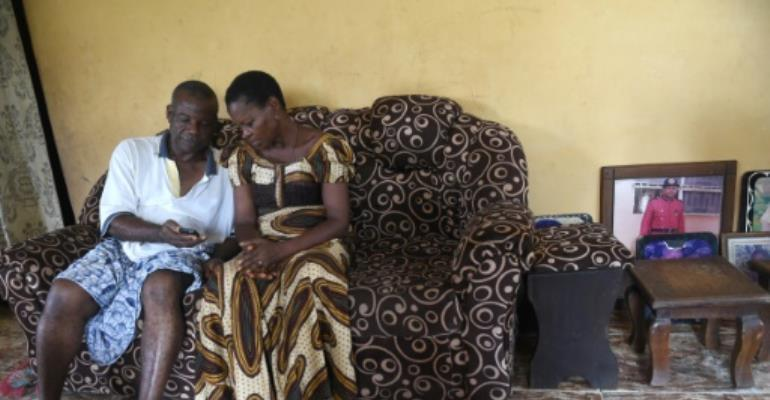 Retired civil servant Sunday Otoide and his wife Grace get financial help from two of their children who have been smuggled into Italy.  By PIUS UTOMI EKPEI (AFP)
