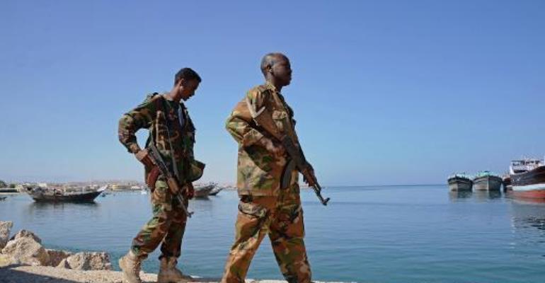 Somali soldiers walk along Bosaso harbor in Puntland on November 18, 2013.  By Mohamed Abdiwahab (AFP/File)