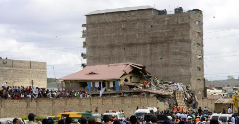 Some 128 people were evacuated from the seven-storey building before it collapsed overnight in a sprawling slum near Nairobi's airport, with the neighbouring structure - of the same height - also evacuated over safety concerns.  By John MUCHUCHA (AFP)