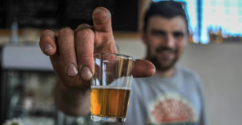 Soon coming to a bar near you: South African craft beer.  By MUJAHID SAFODIEN (AFP)