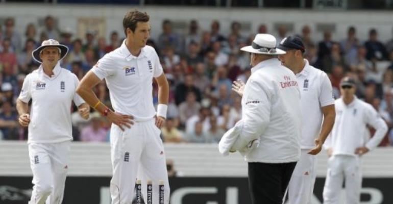 Umpire Steve Davis (right) talks to England's Steven Finn after he calls a dead ball.  By Ian Kington (AFP)