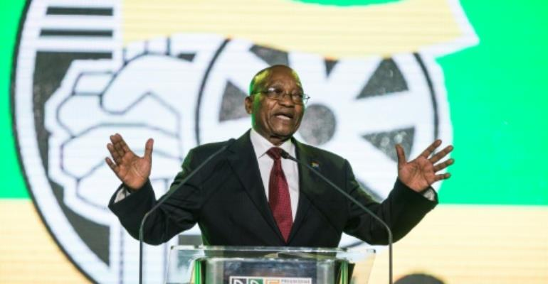South African President Jacob Zuma speaking at a party conference that will elect his successor as head of the ANC.  By WIKUS DE WET (AFP)