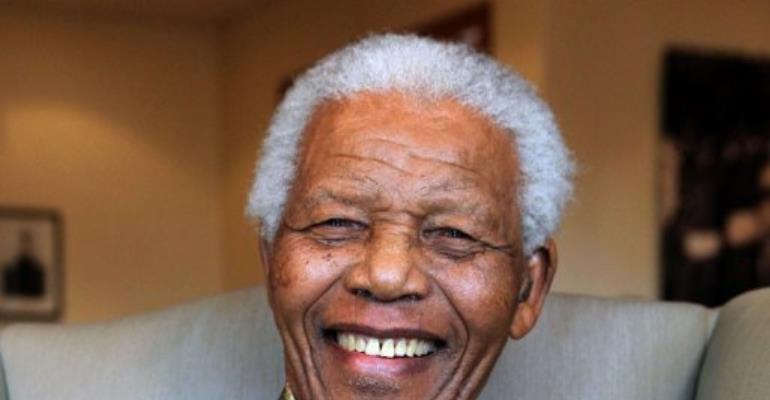 Nelson Mandela will be celebrating his 94th birthday with his family in his village home of Qunu on Wednesday.  By Debbie Yazbek (AFP/MANDELA FOUNDATION/File)