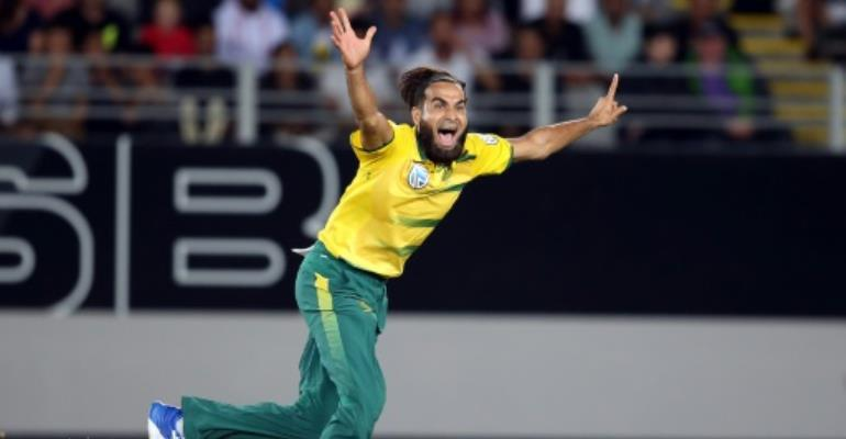 South Africa's Imran Tahir celebrates taking the wicket of New Zealand's Luke Ronchi during the Twenty20 international at Eden Park in Auckland on February 17, 2017.  By Michael BRADLEY (AFP)