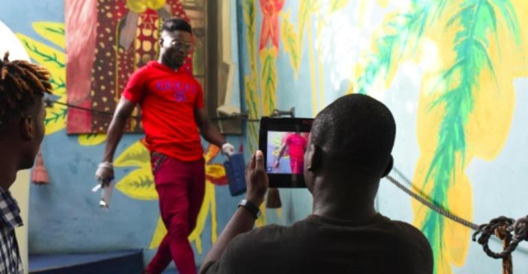 Smartphone filming at a workshop during the Bushman Film Festival at the end of March in Ivory Coast's economic capital Abidjan.  By ISSOUF SANOGO (AFP/File)
