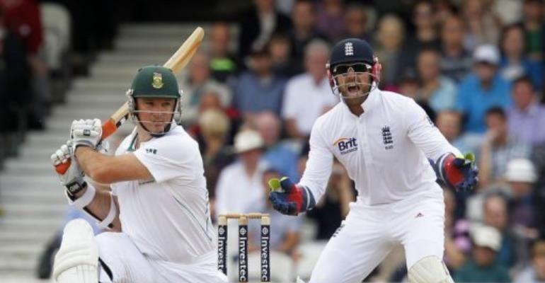 South Africa captain Graeme Smith (L) hits a shot.  By Ian Kington (AFP)