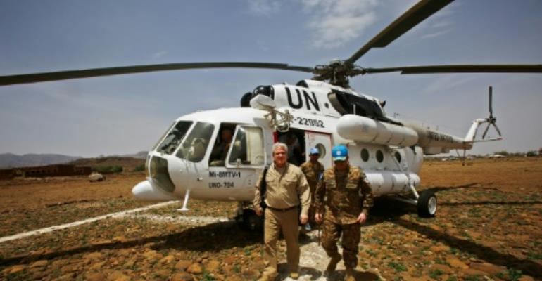 Steven Koutsis, the top US envoy in Sudan, disembarks a UN helicopter after landing in the war-torn town of Golo in the thickly forested mountainous area of Jebel Marra in central Darfur on June 19, 2017.  By ASHRAF SHAZLY (AFP)