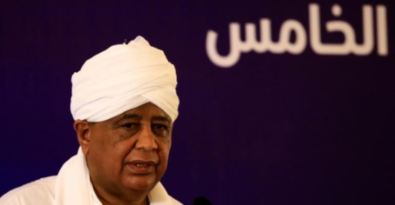 Sudanese Foreign Minister Ibrahim Ghandour addresses a panel discussion on the impact of Washington's decision to end its 20-year-old trade embargo on Sudan in Khartoum on October 7, 2017.  By ASHRAF SHAZLY (AFP)