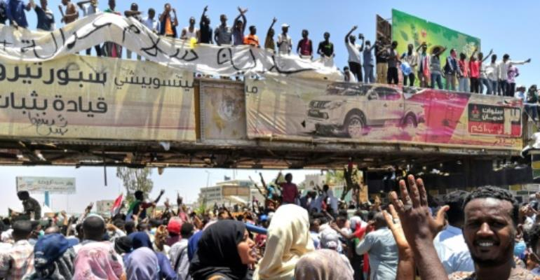 Sudanese protesters rally have been camped for four days outside the army headquarters in Khartoum, defying attempts to disperse them.  By STRINGER (AFP)