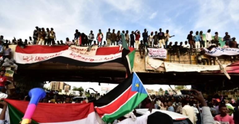 Sudanese protestors have kept up a sit-in outside army headquarters in Khartoum since April 6.  By Ahmed MUSTAFA (AFP)