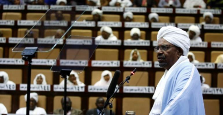 Sudanese President Omar al-Bashir addresses parliament in the capital Khartoum for the first time since he imposed a state of emergency across the country on February 22 in the face of anti-government protests.  By ASHRAF SHAZLY (AFP)