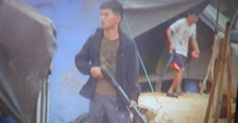 Some of the Chinese illegal miners wielding guns during the confrontation with the locals on Thursday.