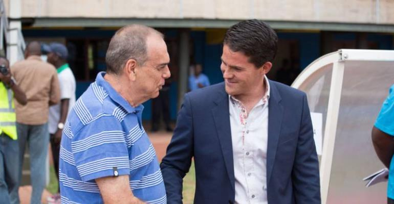 Ghana head coach Avram Grant (L) shakes hands with coach Johnny McKinstry of Rwanda before the game kicks off. (Timothy Kisambira)
