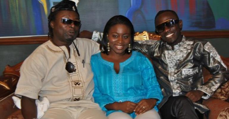 Jackie Ankrah Annan flanked by Amanzeba Nat Brew on the her right and Okyeame Kwame on her left