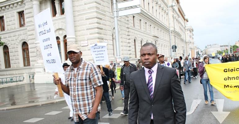 Pastor Joshua Esosa on suit during the protest in Vienna. Photo by Uzoma Ahamefule