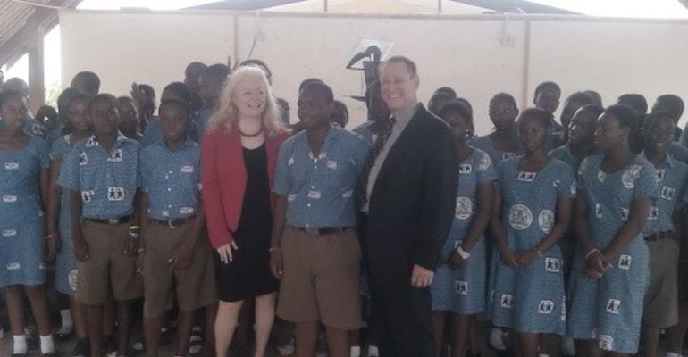 Sharon Lechter and husband in a hearty smile with SOS students