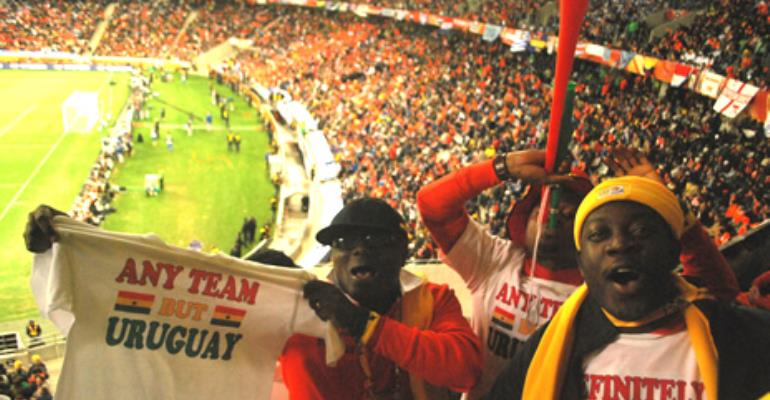 Ghanaian fans backing Holland against Uruguay in the semi final clash at the semi final clash at the Green Point Stadium, Cape Town.