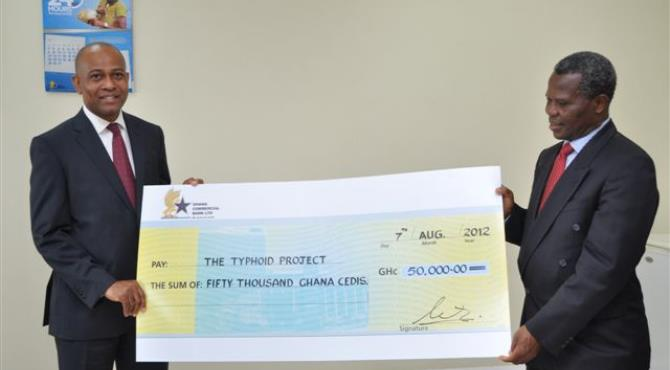 CAPTION Mr. Simon Dornoo Managing Director of Ghana Commercial Bank Ltd. presenting the cheque to Dr. Ben Baako, Consultant Surgeon at Korle-Bu and Project Partner