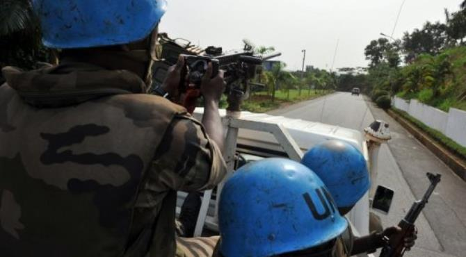 Niger UN peacekeepers patrol in a street of Abidjan in 2011.  By Issouf Sanogo (AFP/File)