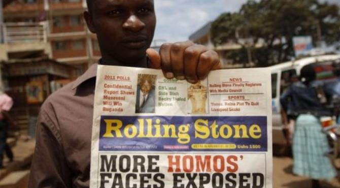 Giles Muhame, managing editor of Uganda's Rolling Stone newspaper, holds a 2010 edition naming 14 men it said were gay.  By Marc Hofer (AFP/File)