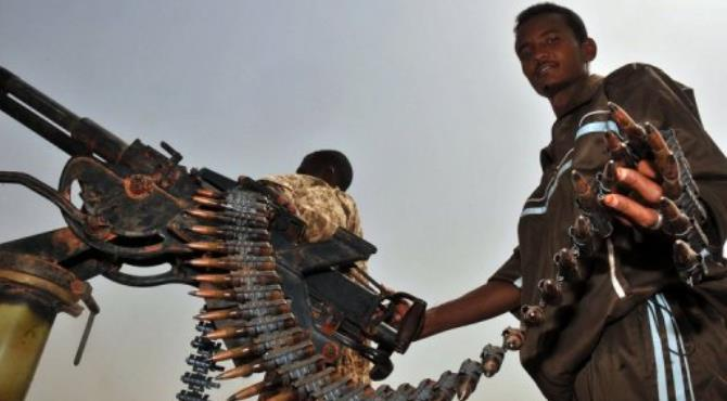A Sudanese soldier and machine gun in the oil town of Heglig bordering with South Sudan on April 24, 2012..  By Ebrahim Hamid (AFP/File)