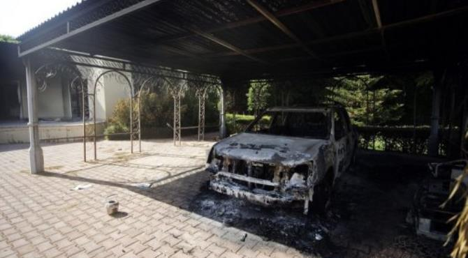 A picture shows a burnt vehicle inside the US consulate compound in Benghazi on September 13.  By Gianluigi Guercia (AFP/File)