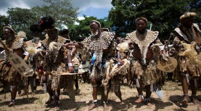Members of the Shembe Church (Nazareth Baptist Church), a traditionalist Zulu church, dance in their leopard-skins to worship God, in Durban, on January 26, 2014.  By Alexander Joe (AFP/File)