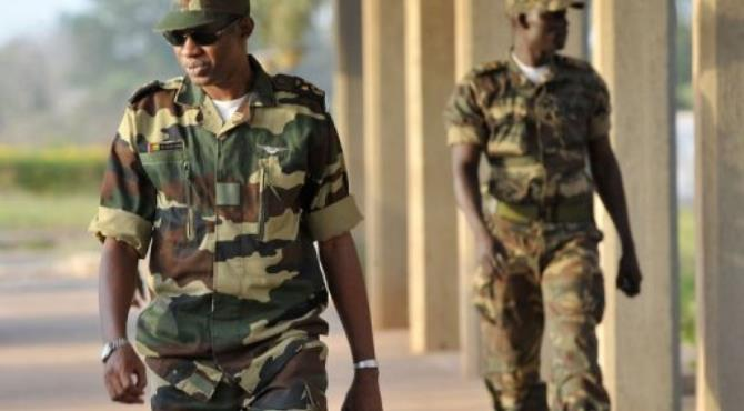 Gerneral Ibrahima Camara, commander-in-chief of Guinea-Bissau's airforce, walks at the airport in Bissau on April 16.  By Seyllou (AFP)