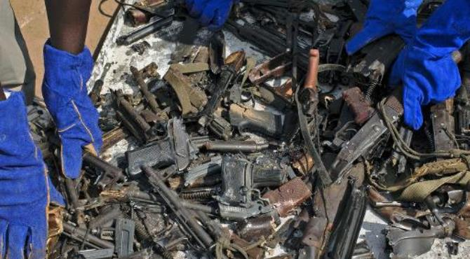 Broken weapons are sorted through at the United Nations Missions in South Sudan (UNMISS) base in Juba after they were broken up to prevent their future use.  By Matthew Abbott (AFP)