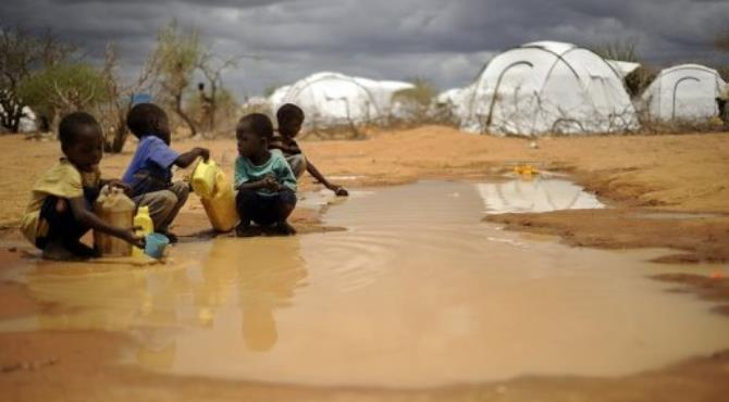 Children gather water in the Dadaab refugee camp.  By Tony Karumba (AFP/File)