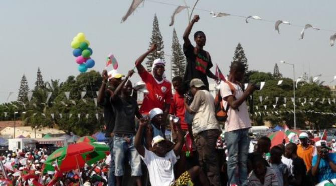 Men stand on a truck as thousands of Angolans take part in a demonstration to ask for free and fair elections.  By Estelle Maussion (AFP/File)