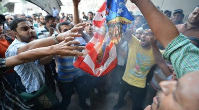Egyptian protesters burn the US flag outside the US embassy in Cairo during a demonstration against a film.  By Khaled Desouki (AFP)