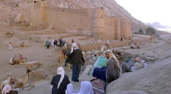 Egyptian Bedouins wait for tourists outside the walls of Saint Catherine monastery.  By Marwan Naamani (AFP/File)