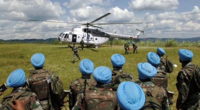United Nations peacekeepers from India wait to board an helicopter in Muhanga.  By Lionel Healing (AFP/File)