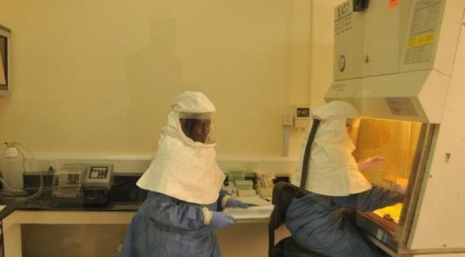 Researchers work in a laboratory of the US Center for Disease Control and Prevention in Uganda.  By Isaac Kasamani (AFP/File)