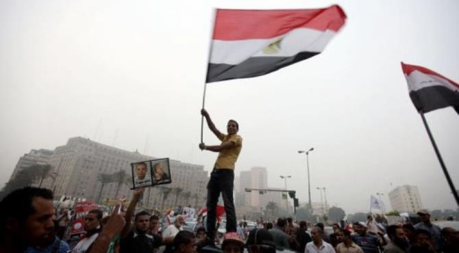 Supporters of the Muslim Brotherhood celebrate in Cairo's Tahrir square in June.  By Patrick Baz (AFP/File)