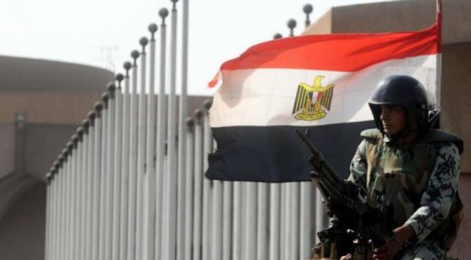 An Egyptian soldier keeps watch during a protest against potential Islamist influence on Egypt's constitution.  By Mohammed Hossam (AFP)