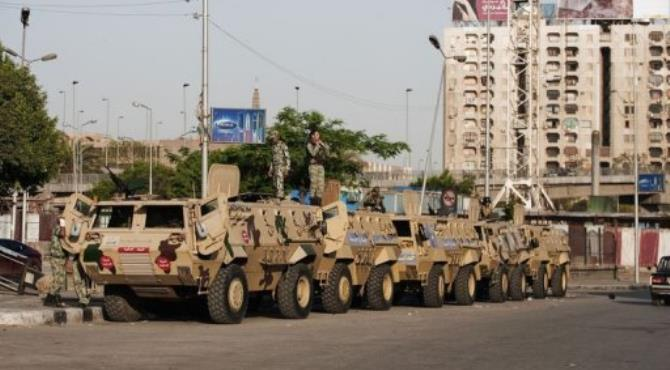 Egyptian soldiers stand on their army armored personnel carriers.  By Gianluigi Guercia (AFP/File)