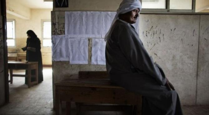 An Egyptian man waits at a polling station in the village of Namul, north of Cairo.  By Marco Longari (AFP)