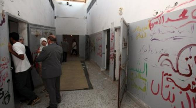 Libyans look inside prison cells at the Abu Slim jail, the scene of a 1996 massacre of prisoners.  By Mahmud Turkia (AFP/File)