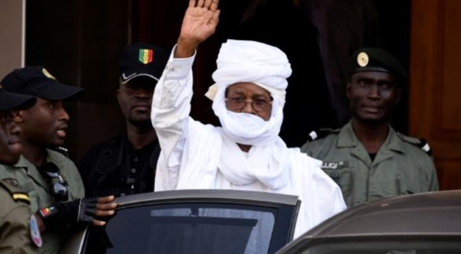 Former Chadian dictator Hissene Habre gestures as he leaves a Dakar courthouse after an identity hearing in June 2015.  By SEYLLOU (AFP/File)