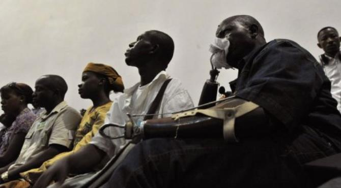A victim in Freetown watches the trial of Liberian ex-leader Charles Taylor in the Hague.  By Issouf Sanogo (AFP)