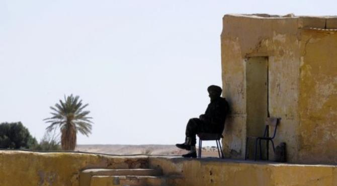 Polisario Front soldiers guard the Presidential palace in 2011 by the Rabuni refugee camp.  By Dominique Faget (AFP/File)