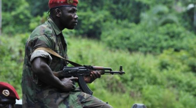 Ivory Coast soldiers patrol in the village of Para on June 17.  By Issouf Sanogo (AFP/File)