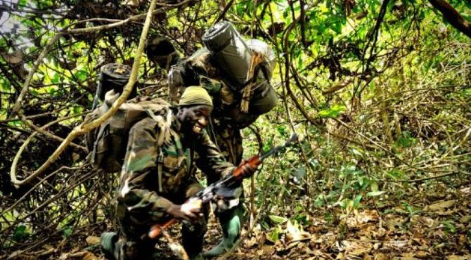 Ugandan soldiers patrol on April 19, 2012 during an operation to flush out LRA leader Joseph Kony.  By  (AFP/FIle)
